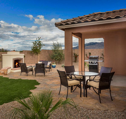 Scene overlooking the backyard of an Arizona home, with seating and firepit