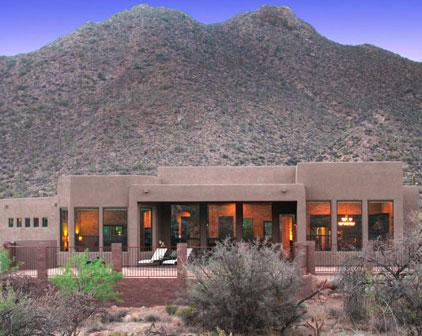 Image of an adobe home beneath a small mountain in Tucson, Arizona