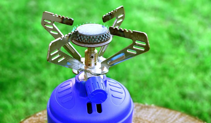 Focus on the burners when cleaning a camp stove